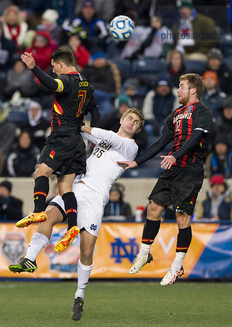 Dec 15, 2013; Notre Dame midfielder Brandon Aubrey battles for the ball against Maryland midfielder Dan Metzger and defender Jereme Raley in the College Cup championship in Chester, Pa. Photo by Barbara Johnston/University of Notre Dame