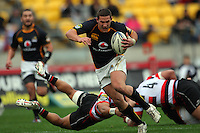 Wellington's Shaun Treeby beats a tackle. ITM Cup - Wellington Lions v Counties-Manukau Steelers at Westpac Stadium, Wellington, New Zealand on Sunday, 8 August 2010. Photo: Dave Lintott/lintottphoto.co.nz.
