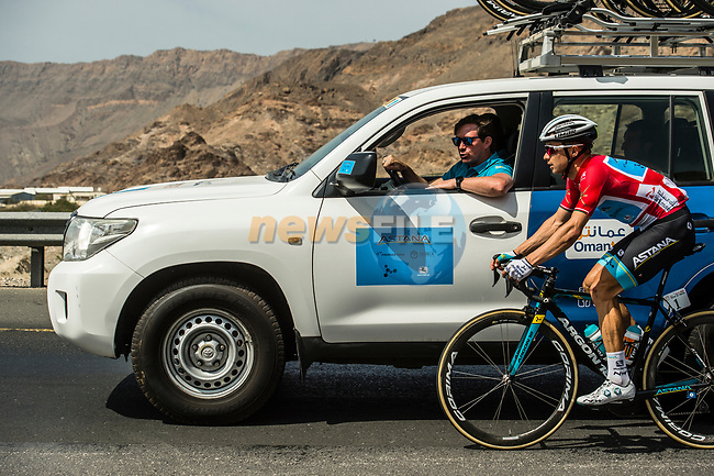 Race leader Alexey Lutsenko (KAZ) Astana Pro Team talks to the team car during Stage 4 of 10th Tour of Oman 2019, running 131km from Yiti (Al Sifah) to Oman Convention and Exhibition Centre, Oman. 19th February 2019.<br /> Picture: ASO/Kåre Dehlie Thorstad | Cyclefile<br /> All photos usage must carry mandatory copyright credit (© Cyclefile | ASO/Kåre Dehlie Thorstad)