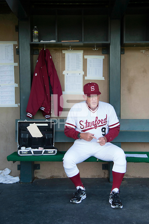 Stanford, CA - Friday, March 1, 2013: Stanford Cardinal head coach Mark Marquess sits in the dugout during the NCAA baseball game against the Texas Longhorns.