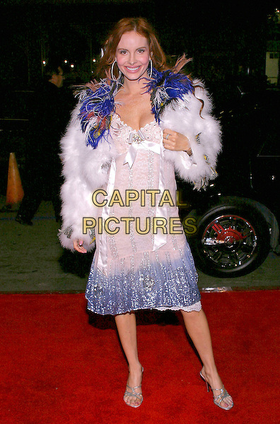 """PHEOBE PRICE.2004 AFI Fest Los Angeles presents the North American Premiere of """"A Very Long Engagement"""" held at the Mann's Chinese Theatre, Hollywood, California, USA,.10th November 2004  .full length white beaded dress satin ribbon bow fluffy fur jacket coat blue feathers.Ref: ADM.www.capitalpictures.com.sales@capitalpictures.com.©JW/AdMedia/Capital Pictures ."""