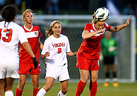 BOYDS, MARYLAND - April 06, 2013:  Hayley Siegel (17) of The Washington Spirit of the University heads the ball away from Morgan Brian (6) of Virginia women's soccer team in a NWSL (National Women's Soccer League) pre season exhibition game at Maryland Soccerplex in Boyds, Maryland on April 06. Virginia won 6-3.