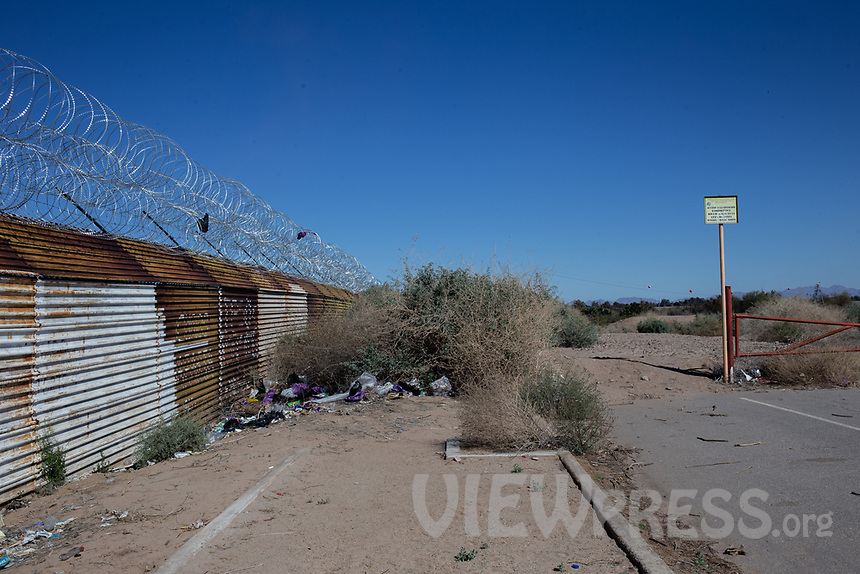 MEXICALI, MEXICO - March 14. A general view of the US-Mexico Border where the river ends on March, 14  2019 in Mexicali, Mexico.<br /> The rivers usually end in the sea, the Colorado dies in a border. Its the only case like this in the world. There is less water in the Colorado River, hence less water in crops and areas of northern Mexico.  <br /> (Photo by Luis Boza/VIEWpress)