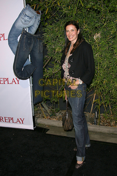 MIMI ROGERS.Los Angeles Replay Store Opening and Launch of The Brandon Davis Jean by Replay - Arrivals held at Falcon, Hollywood, California, USA, 24 April 2005..full length black jacket fendi bag.Ref: ADM/ZL.www.capitalpictures.com.sales@capitalpictures.com.©Zach Lipp/AdMedia/Capital Pictures.