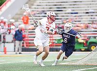 College Park, MD - May 13, 2018: Maryland Terrapins Bubba Fairman (2) is being defended by Robert Morris Colonials Daniel Smith (6) during the NCAA first round game between Robert Morris and Maryland at  Capital One Field at Maryland Stadium in College Park, MD.  (Photo by Elliott Brown/Media Images International)