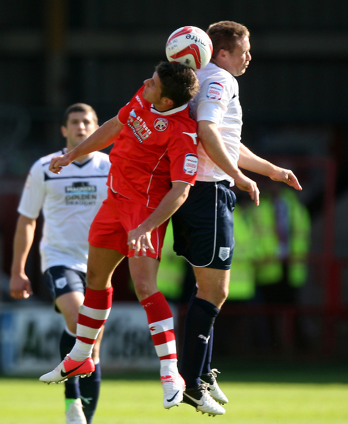 Preston North End's Joel Byrom jumps with Walsall's Flo Cuvelier..Football - npower Football League Division One - Walsall v Preston North End - Saturday 22nd September 2012 - Banks's Stadium - Walsall..