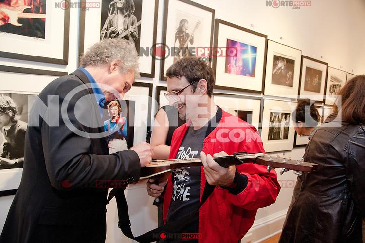 "Bob Gruen signs a guitar for a guest at the Bob Gruen ""Rock Seen"" photo exhibition at Art629 in New York City. May 4, 2012. ©Kristen Driscoll/MediaPunch Inc."