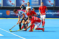 Mark Gleghorne of England tackles Ignacio Ortiz of Argentina during the Hockey World League Semi-Final match between England and Argentina at the Olympic Park, London, England on 18 June 2017. Photo by Steve McCarthy.