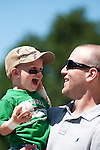 June 30, 2009 -- Omaha Royals left fielder Scott Thorman, from Cambridge, Ontario, talks with his son Robbie, 2, after the game against the Albuquerque Isotopes in a minor league professional baseball game on Tuesday June 30, 2009 in Omaha, Nebraska. PHOTO/Daniel Johnson