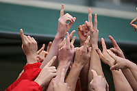 18 February 2006: The team huddles during Stanford's 136-107 win over the California Golden Bears at the Avery Aquatic Center in Stanford, CA.