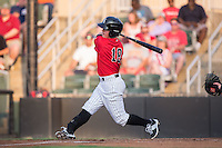 Bradley Strong (18) of the Kannapolis Intimidators follows through on his swing against the Hagerstown Suns at Kannapolis Intimidators Stadium on July 4, 2016 in Kannapolis, North Carolina.  The Intimidators defeated the Suns 8-2.  (Brian Westerholt/Four Seam Images)