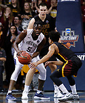SIOUX FALLS, SD: MARCH 22:  Lewis Diankulu #5 of Queens (NC) tries to protect the ball from Northern State defenders Ian Smith #0 and Carter Evans #54 during their game at the 2018 Division II Men's Basketball Championship at the Sanford Pentagon in Sioux Falls, S.D. (Photo by Dick Carlson/Inertia)