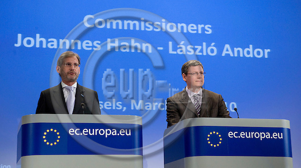 Brussels-Belgium - March 31, 2010 -- Johannes HAHN (le), European Commissioner from Austria and in charge of Regional Policy, with László (Laszlo) ANDOR (ri), European Commissioner from Hungary and in charge of Employment, Social Affairs and Inclusion, during a joint press conference in the HQ of the EC -- Photo: Horst Wagner / eup-images