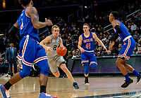 WASHINGTON, DC - DECEMBER 28: Jacob Boonyasith #41 of American goes after Mac McClung #2 of Georgetown. during a game between American University and Georgetown University at Capital One Arena on December 28, 2019 in Washington, DC.