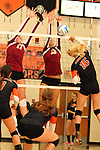 SIOUX FALLS, SD - OCTOBER 1:  Maggie DeJong #17 and Tagyn Larson #13 from Roosevelt double team for a block on Peyton VandeBrake #15 from Washington in the second game of their match Tuesday night at Washington. (Photo by Dave Eggen/Inertia)