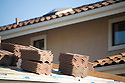 Stacks of red brick roof tiles on a roof. Cupertino, California, USA