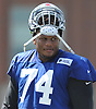 Ereck Flowers #74 of the New York Giants lifts his helmet to cool off on a hot and humid day of training camp at Quest Diagnostics Training Center in East Rutherford, NJ on Friday, Aug. 3, 2018.