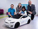 12/11/19<br /> <br /> L/R:  Toni Hadley (Play and Recreation Facilitator), Helen Rawnsley (Corporate Partnerships Officer), and John Berry (WPD) with Nusaybah Nassar at the wheel of the Tesla.<br /> <br />  Jon Berry from WPD's Innovation Team presents Birmingham Children's Hospital with a model electric Tesla car.<br /> <br /> <br /> All Rights Reserved: F Stop Press Ltd.  <br /> +44 (0)7765 242650 www.fstoppress.com