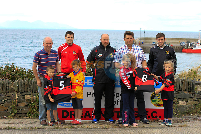 Paul Boyd (General Manager Fishermen's Co-op), Pat Lynch (Dreadnots), Colin Kelly (Manager Dreadnots), Barry Faulkner (Fishermen's Co-op) and Padraic Smyth (Dreadnots) with Dreadnots Under-Age Kids Rian Keogh, Donnacha Skinnader, Ella Carter and Anna Sharkey during the Clogherhead Fishermen's Co-op Ltd sponsorship with the Dreadnots GFC on Tuesday 19th August 2014.<br />