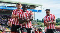Lincoln City's John Akinde, centre, celebrates scoring the opening goal from the penalty spot with team-mates Harry Toffolo, left, and Bruno Andrade<br /> <br /> Photographer Chris Vaughan/CameraSport<br /> <br /> The EFL Sky Bet League Two - Lincoln City v Swindon Town - Saturday 11th August 2018 - Sincil Bank - Lincoln<br /> <br /> World Copyright &copy; 2018 CameraSport. All rights reserved. 43 Linden Ave. Countesthorpe. Leicester. England. LE8 5PG - Tel: +44 (0) 116 277 4147 - admin@camerasport.com - www.camerasport.com