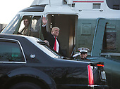 United States President Donald J. Trump waves as he boards Marine One after visiting with military members and their families at Walter Reed National Military Medical Center in Bethesda, Maryland on December 21, 2017. Credit: Chris Kleponis - Pool via CNP