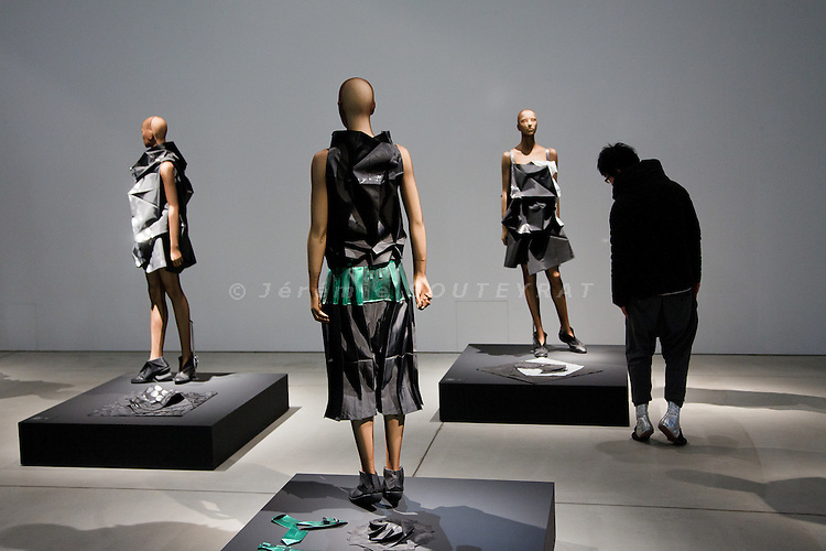"Tokyo, December 2010 - 21_21 Design sight museum in the Roppongi area, during Issey Miyake's exhibition ""Reality lab"". The exhibition shows models with Miyake's lastest collection clothes, called 132 5. The collection was created from a fusion of both theoretical math, attractive design inspired by origami and a hi-tech new polyester fabric made from recycled plastic bottles. In the name ""132 5,"" the numeral ""1"" refers to the single piece of cloth, ""3"" to its 3D shape, which can be folded back into ""2,"" or two dimensions. The ""5"" corresponds to the multiple ways each garment can be worn."