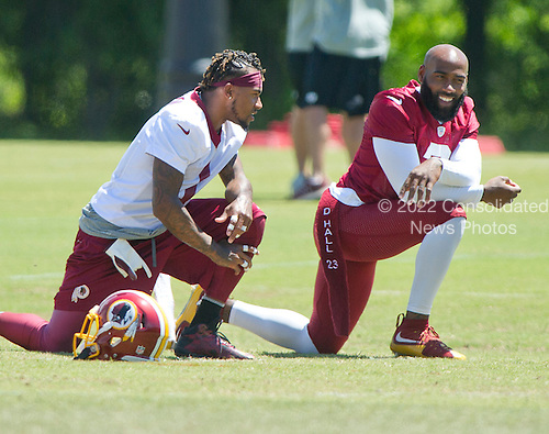Washington Redskins wide receiver DeSean Jackson (11), wearing jersey number 1 for practice, and safety DeAngelo Hall (23), wearing jersey number 2 for practice, share conversation as they participate in drills during the Veteran Minicamp at Redskins Park in Ashburn, Virginia on Tuesday, June 14, 2016.<br /> Credit: Ron Sachs / CNP