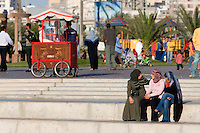 Tripoli, Libya, North Africa - Modern Libyan Women's Clothing Styles as seen in Public Park near the Green Square, downtown Tripoli.  Girls Talking.