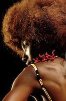 A model wears a coral jewel.