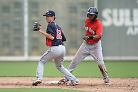 Minnesota Twins shortstop Ryan Walker (12) and Manuel Margot look to the umpire for the call during an Instructional League game against the Boston Red Sox on September 26, 2014 at jetBlue Park at Fenway South in Fort Myers, Florida.  (Mike Janes/Four Seam Images)