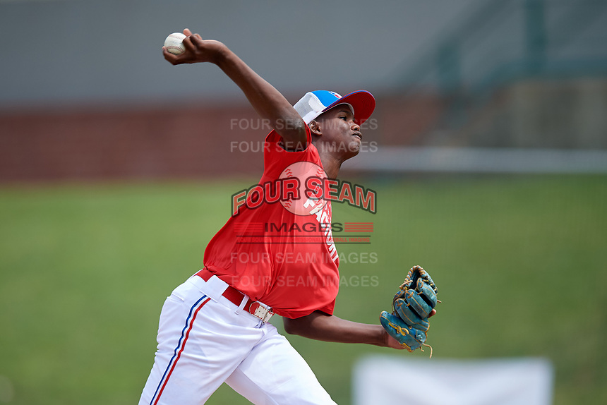 Darlin Sano (14) delivers a pitch during the Dominican Prospect League Elite Underclass International Series, powered by Baseball Factory, on July 21, 2018 at Schaumburg Boomers Stadium in Schaumburg, Illinois.  (Mike Janes/Four Seam Images)