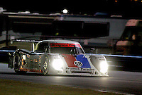 The #58 Brumos Porsche of David Donohue, Darren Law, Buddy Rice and Antonio Garcia races to victory in the Rolex 24 at Daytona , Daytona International Speedway, Daytona Beach, FL, January 2009.  )Photo by Brian Cleary)