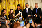 United States President Barack Obama, First Lady Michelle Obama and Vice president Joe Biden watch as Dina Retik lights the second candle of the menorah during a reception for Hanukkah in the East Room of the White House in Washington, DC, Thursday, December 2, 2010.  Hanukkah marks the 8-day Jewish celebration of the Festival of Lights.    .Credit: Mike Theiler - Pool via CNP