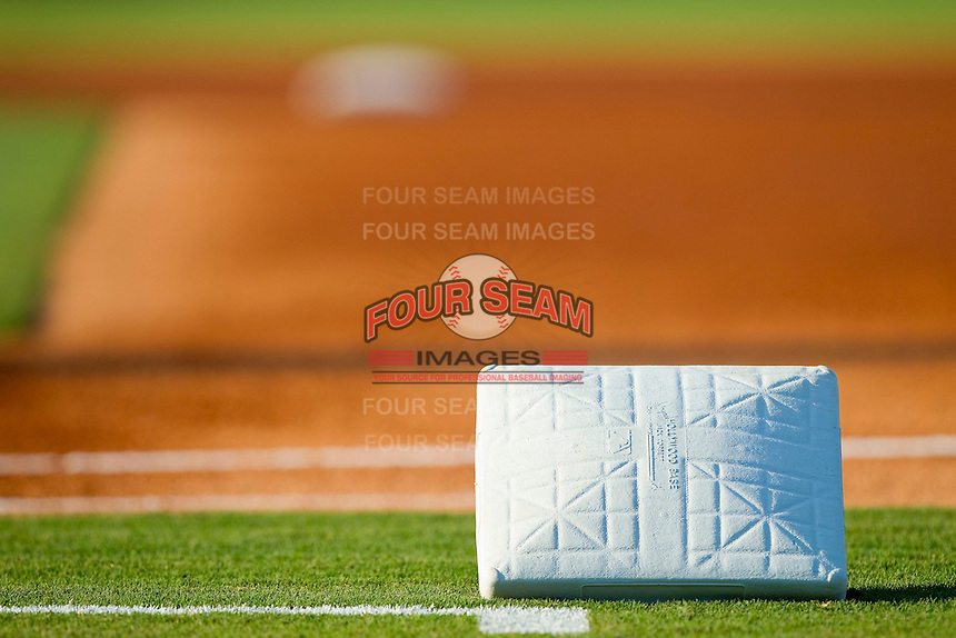 A clean first base waits to be put into place prior to the International League game between the Durham Bulls and the Charlotte Knights at Knights Stadium on August 2, 2011 in Fort Mill, South Carolina.  The Bulls defeated the Knights 18-3.   (Brian Westerholt / Four Seam Images)