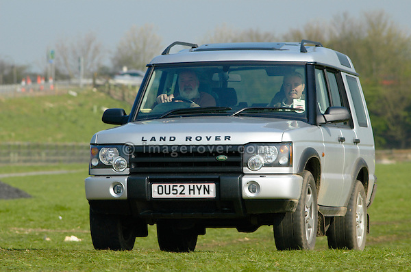Land Rover Discovery 2 arriving at the Old Sodbury Land Rover Sortout on April 2 at Newbury Showground UK 2005. The Old Sodbury Sortout is the biggest autojumble for buying and selling Land Rover parts.