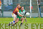 The Bernard O'Callaghan Memorial Senior Football Championship 2013, Round 1 Ballyduff (white/green) V Duagh (Red) which took place on Sunday in Frank Sheehy Park, Listowel.  Referee: Billy McElligot, Listowel Emmets.<br /> <br /> Barry O'Grady of Ballyduff being defeated by Maurice O'Connor of Duagh with some excellent defending.