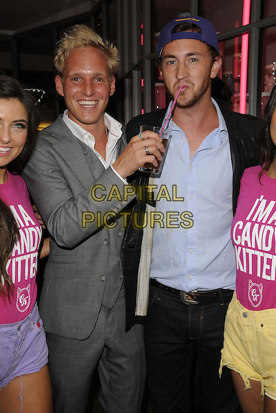 Jamie Laing & Francis Boulle.The Candy Kittens pop up shop launch party, Candy Kittens, London, England, August 7th, 2012.half length grey gray suit waistcoat black jacket blue shirt backwards baseball cap hat drink beverage smiling funny drinking beard facial hair.CAP/CAN.©Can Nguyen/Capital Pictures.