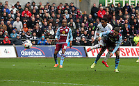 Sunday, 26 April 2014<br /> Pictured: Jonathan de Guzman (2nd R) takes a shot at goal, challenged by Matthew Lowton of Aston Villa (R).<br /> Re: Barclay's Premier League, Swansea City FC v Aston Villa at the Liberty Stadium, south Wales.