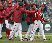 NWA Democrat-Gazette/ANDY SHUPE<br />Arkansas closer Matt Cronin is congratulated by teammates after closing out the Razorbacks' 2-1 win over South Carolina Saturday, April 14, 2018, at Baum Stadium. Visit nwadg.com/photos to see more photographs from the game.