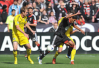 Rafael Teixeira (9) of D.C. United goes against Columbus Crew Danny O'Rourke (5) The Columbus Crew defeated D.C. United  2-1, at RFK Stadium, Saturday March 23, 2013.