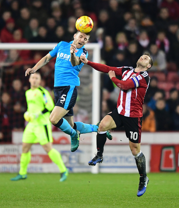 Fleetwood Town's Ashley Eastham vies for possession with Sheffield United's Billy Sharp<br /> <br /> Photographer Chris Vaughan/CameraSport<br /> <br /> The EFL Sky Bet League One - Sheffield United v Fleetwood Town - Tuesday 24th January 2017 - Bramall Lane - Sheffield<br /> <br /> World Copyright &copy; 2017 CameraSport. All rights reserved. 43 Linden Ave. Countesthorpe. Leicester. England. LE8 5PG - Tel: +44 (0) 116 277 4147 - admin@camerasport.com - www.camerasport.com