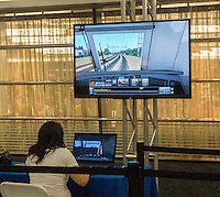 Visitors to Penn Station in New York try out a train simulator during National Train Day on Saturday, May 10, 2014. Organized by Amtrak and in its seventh year National Train Day endeavors to promote train travel and an understanding of the economic revitalization brought by train travel. (© Richard B. Levine)