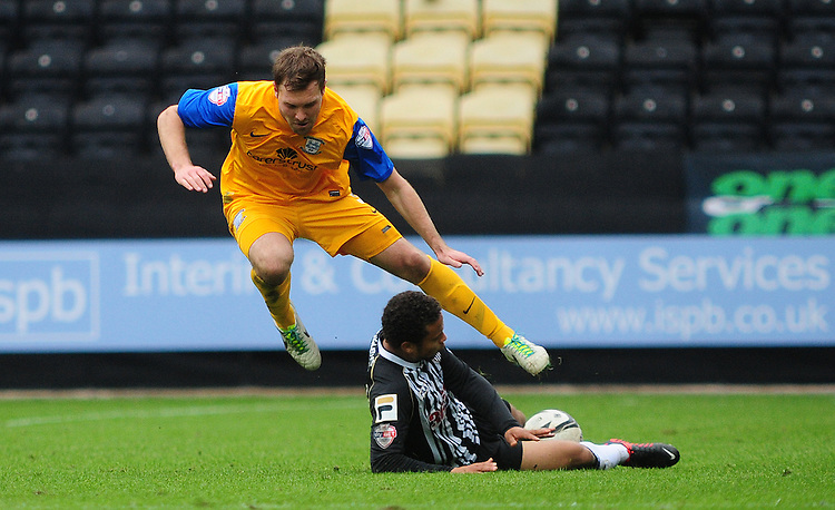 Preston North End's Scott Laird is tackled by Notts County's Curtis Thompson <br /> <br /> Photo by Chris Vaughan/CameraSport<br /> <br /> Football - The Football League Sky Bet League One - Notts County v Preston North End - Saturday 26th October 2013 - Meadow Lane - Nottingham<br /> <br /> &copy; CameraSport - 43 Linden Ave. Countesthorpe. Leicester. England. LE8 5PG - Tel: +44 (0) 116 277 4147 - admin@camerasport.com - www.camerasport.com