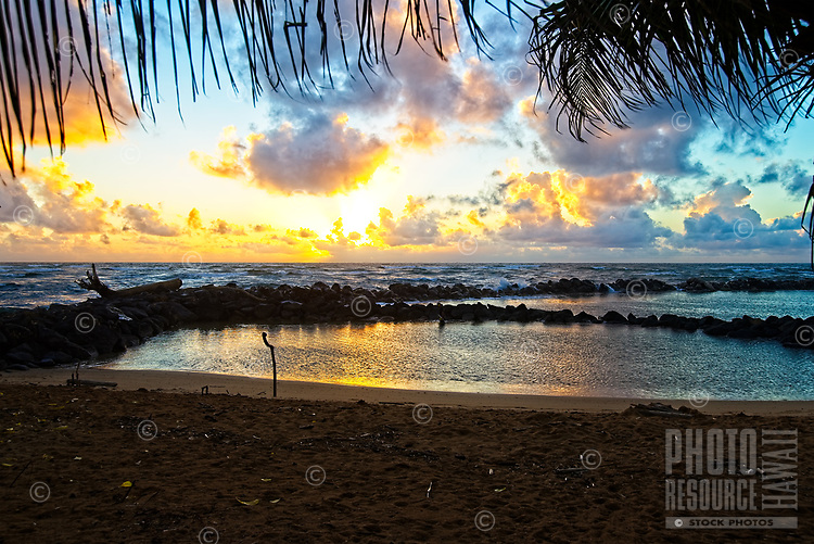 Sunrise over a swimming pond at Lydgate Beach Park, Kapa'a, Kaua'i. The pond is supposed to be one of the safest places for children to swim on the island.
