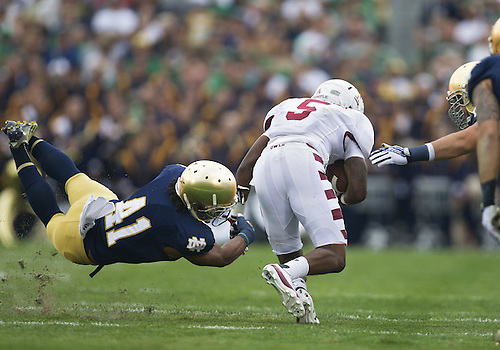 August 31, 2013:  Temple wide receiver Jalen Fitzpatrick (5) runs the ball as Notre Dame safety Matthias Farley (41) attempts to make tackle during NCAA Football game action between the Notre Dame Fighting Irish and the Temple Owls at Notre Dame Stadium in South Bend, Indiana.  Notre Dame defeated Temple 28-6.