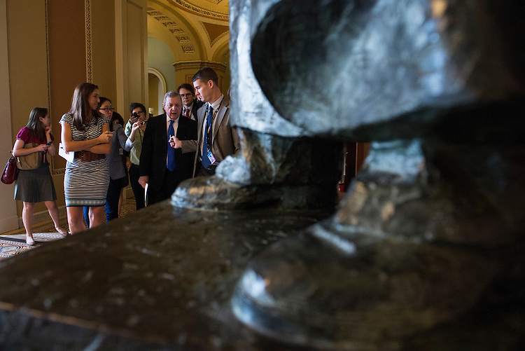 UNITED STATES - MAY 21: Sen. Richard Durbin, D-Ill., speaks with reporters as he walks to the Senate policy luncheon in the Capitol on Tuesday, May 21, 2013. (Photo by Bill Clark/CQ Roll Call)