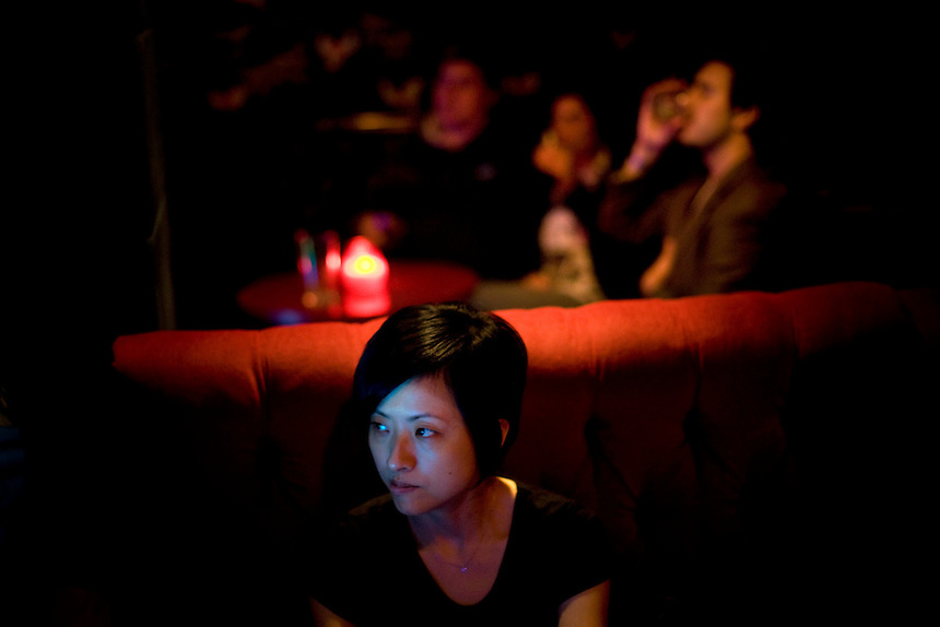 A young woman watches the dancefloor at the Electricity Showrooms bar in Hoxton Square. In its heyday, London?s best artists and trendsetters lived in Hoxton before developers transformed it into one of London?s more expensive areas. Despite high levels of gentrification, Hoxton continues to be home to some of the most deprived communities in Britain, concentrated in nearby housing estates.