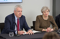 (L-R) First Minister for Wales Carwyn Jones signs alongside Britain Prime Minister Theresa May during the Bay City Region deal, at the Liberty Stadium, Swansea, Wales, UK. Monday 20 March 2017.