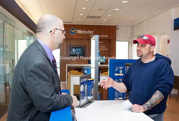 WATERBURY CT-MAY 01 2013- 050113DA02- Bob Kelly, branch manager of Webster Bank in Waterbury, left,  talks with Dan Nadeau of Wolcott and advises him on accounts and merchant services which is part of their universal banking system..Darlene Douty Republican American