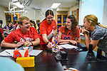 Ph.D. candidate and teaching assistant J.P. Lawrence critiques a DNA model assembled by Biology Bootcamp students Dylan Carpenter, Isabelle Garlotte and Leona Craig. Photo by Robert Jordan/Ole Miss Communications
